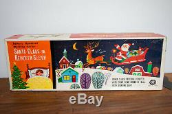 1950's BATTERY OPERATED SANTA CLAUS ON REINDEER SLEIGH TIN LITHO TOY