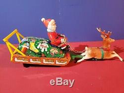 Battery Operated Santa Claus On Reindeer Sleigh Tin Toy tested original box
