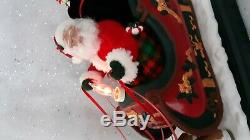 Holiday Creations Animated Musical Santa with Reindeer and Sleigh in Box