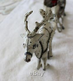 Hubley (1895- 1925) cast iron Santa in sleigh pulled by one reindeer