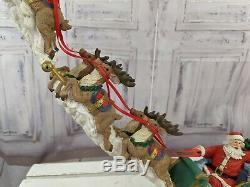 Jaimy santa sleigh reindeer sculpture decor centerpiece holiday village
