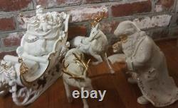 NIB Grandeur Noel Porcelain Santa and Sleigh Set withReindeer Collector's Edition