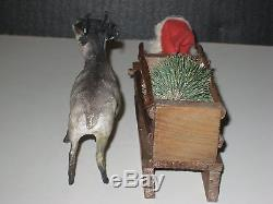 OLD REINDEER SLEIGH WITH XMAS TREE DRIVEN BY SANTA, ALL GERMAN
