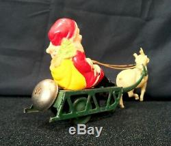 Vintage Tin Windup Celluloid Santa Claus With Sleigh Reindeer Bell Toy Christmas